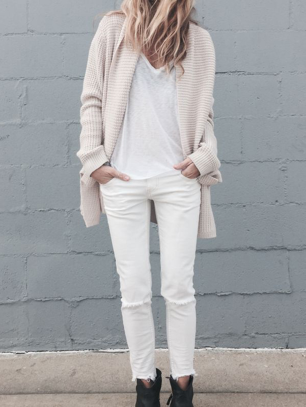 justthedesign :      Laura Wiertzema  is wearing a  white heavy knit cardigan
