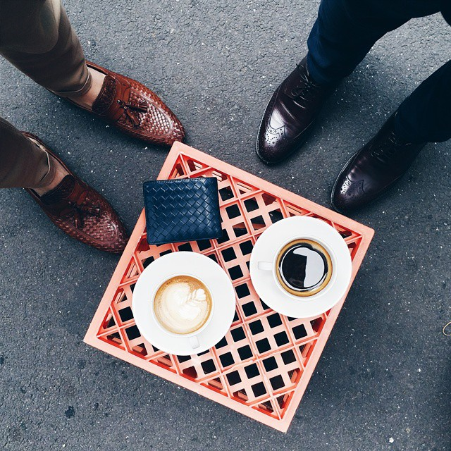"Lunchtime meetings look a bit like this with @the.tailored.man . ""Dress Well. Drink Well. Live Well."" ☕👞"