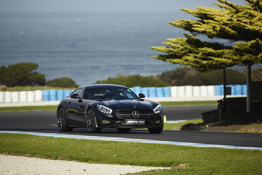 Mr. Gumbatron exiting the axpex in the Mercedes Benz AMG GT-S