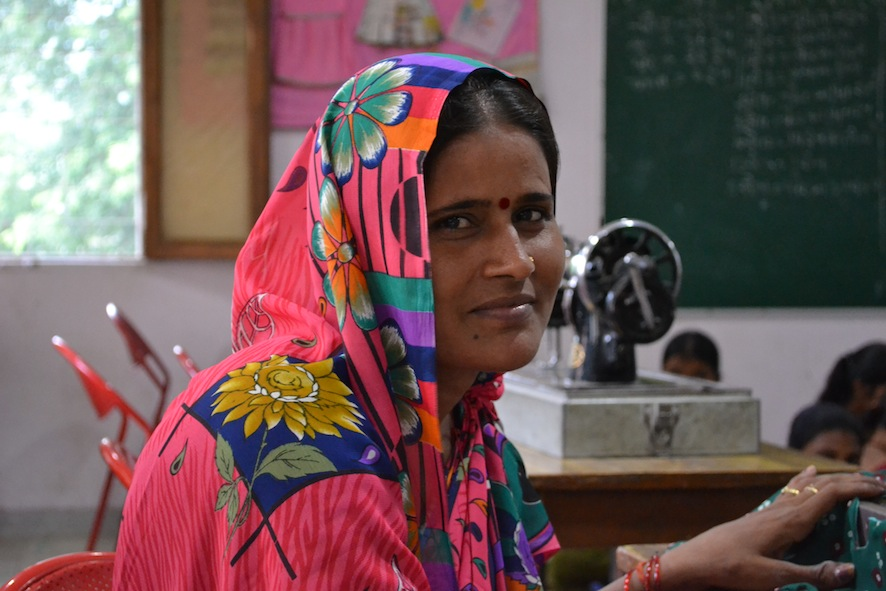 A female student learns vocational skills to support her sick husband. Her daughter is on full scholarship at the Dayawanti Punj Model School next door.