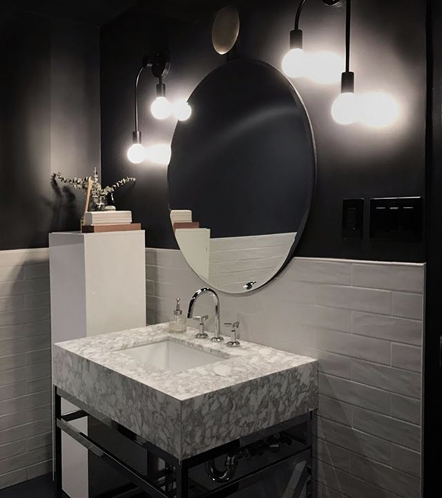 Love a #moody WC. Designed by @lorenzocota for our Flatiron project. #schoolhouseelectric #dark #interiordesign #officedesign #restroom #nemotile #marble #black