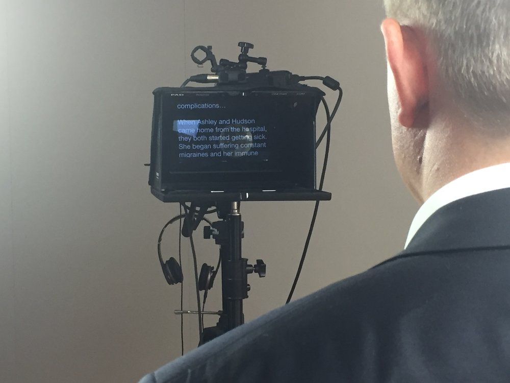 A view from the client's perspective of the teleprompter and script.