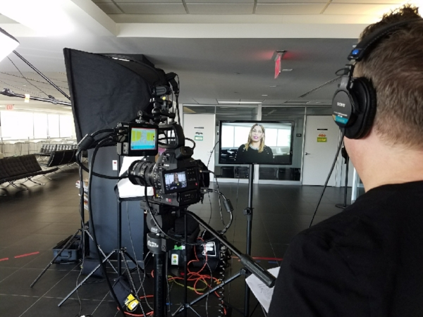 Keeping an eye on the monitor during the filming of a television commercial.