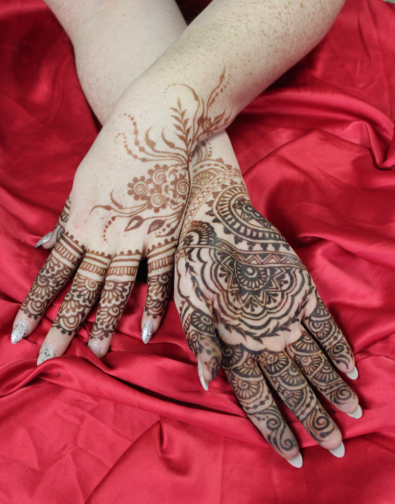 In this bridal mehndi her palms took the henna stain so well the color is a super dark espresso, and you can clearly see how the back of her hand and wrists get much lighter stains. Henna by Deborah Brommer