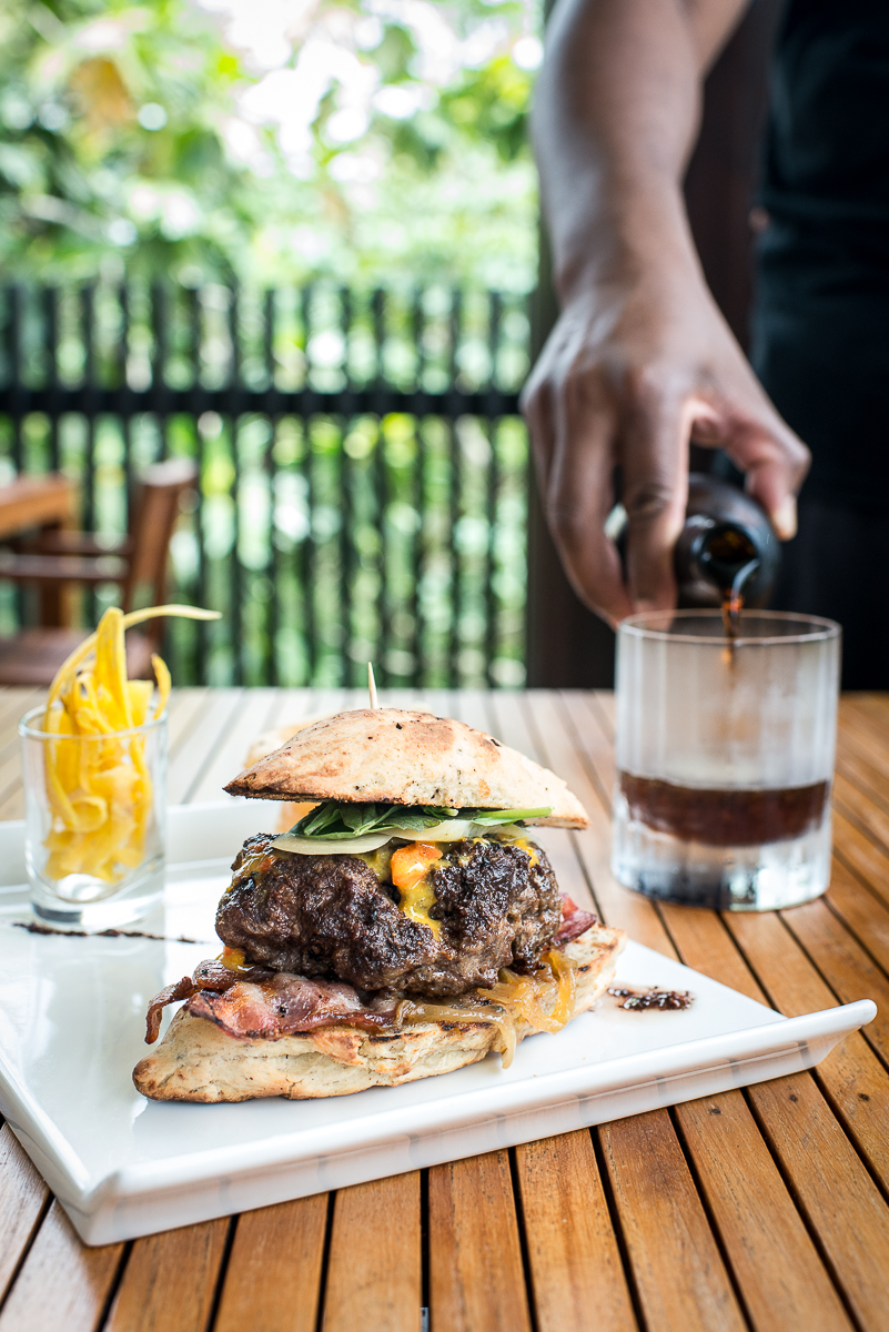 Everything relates back to chocolate at Hotel Chocolat, even the burger. The bun is shaped like a cacao pod, and the burger is made with cacao nibs and served with a cacao nib vinaigrette on the side. Meanwhile the porter is made with cacao shells. Photo by Jenny Sathngam