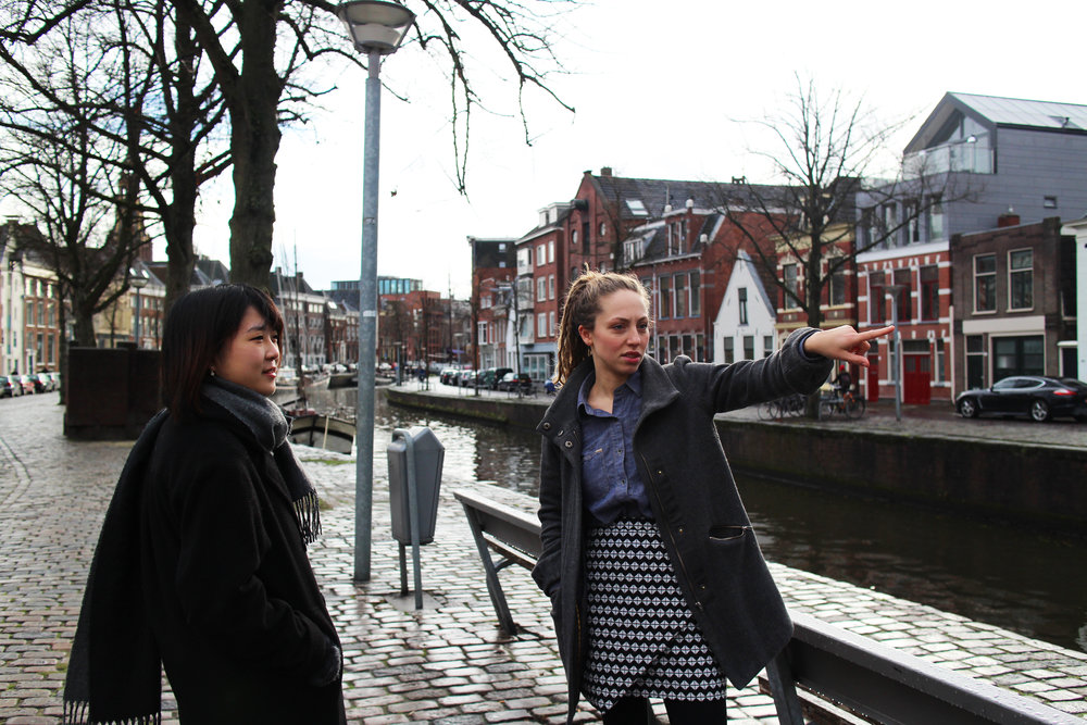 Azusa and myself standing in the streets of Groningen. I am pointing towards the Noorderplantsoen, the park pictured below. To the right, Azusa sips a cup of MASMAS coffee. Below, we stand with my very Dutch bicycle next to a pond in the Noorderplantsoen.