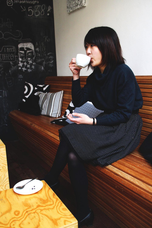 Azusa Sips Coffee