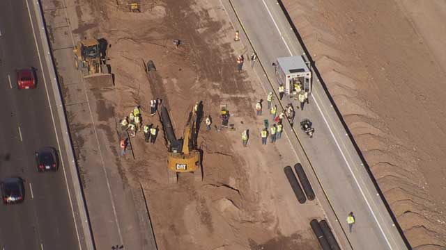 When it was recognized that the men were pinned, the backhoe operator lifted the bucket up.