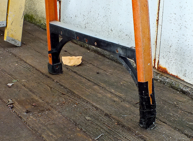 Damaged footpad/assembly on this step ladder was poorly taped over in a bad attempt to fix the ladder. (Don't do this.)