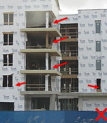 Although guardrails have been installed in some areas at this job site, notice the broken sections both on the open edges and at windows.