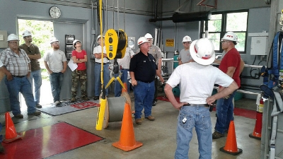 Crane operation and safety training held on-site for employees.