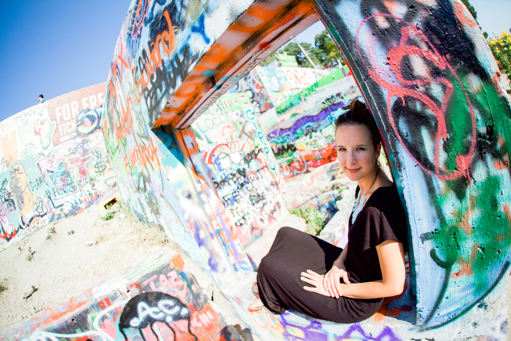 A photo of Katie at the graffiti park in Austin, Texas.