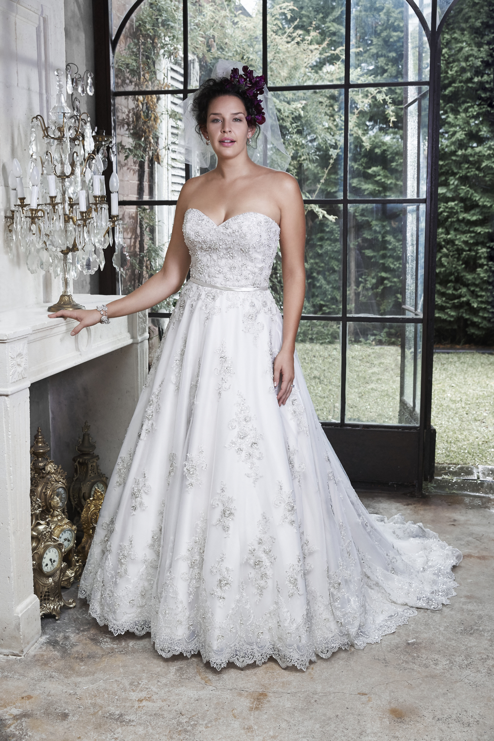 Hannah -  Fall in love all over again in this dreamy ballgown, delicately placed embroidered lace on tulle sparkles with metallic thread and Swarovski crystals. Complete with a delicate waistband and zipper over inner elastic closure.    Colors available - White/Pewter Accent, Ivory/Pewter Accent, Champagne/Pewter Accent