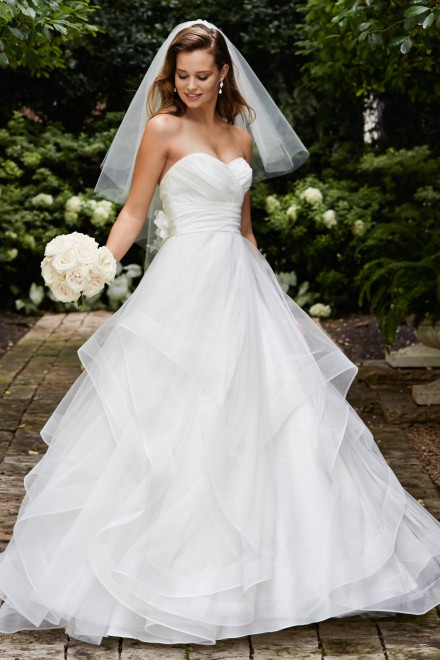 Selena -   Simple and stunning, this tulle ballgown features a silky taffeta ruched bodice and waistband, sweetheart neckline, and multi-layer skirt with horsehair hem. Two silky taffeta and tulle flowers with crystal centers accent the back bodice perfectly. Chapel train.    Colors available - Ivory