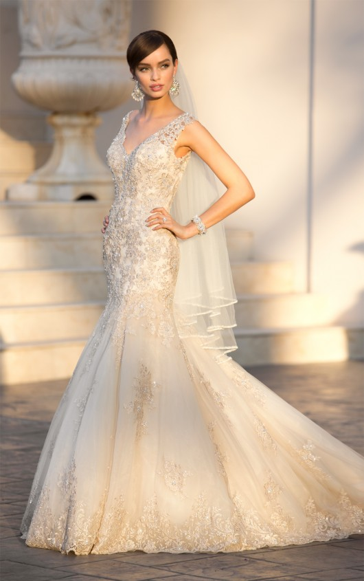 5922 - Stunning lace mermaid gown accented with lace and beading. This gown features a v neckline and v back accented with a zipper.  Colors available - White, Ivory, Gold