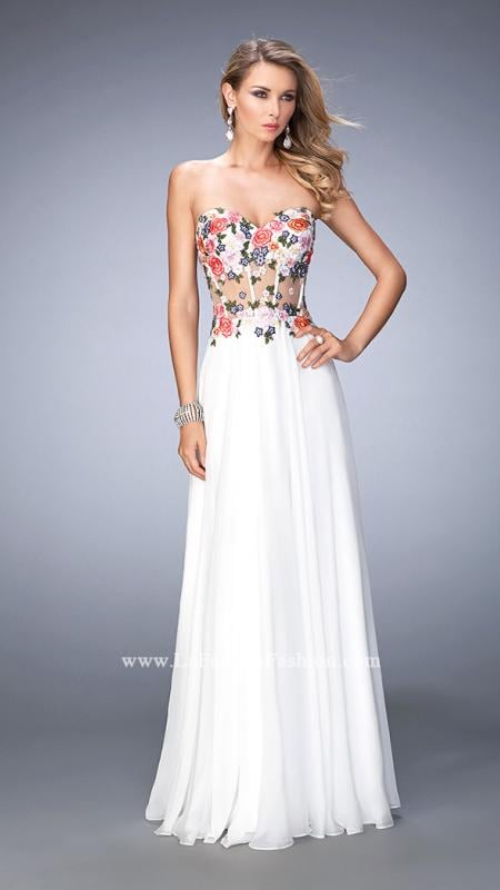 LaFemme 22709 -   Graceful chiffon gown with a sweetheart neckline and sheer midriff and back. The bodice is embellished with exposed boning and stunning floral lace applique with scattered rhinestones. Back zipper closure.    Colors available - White