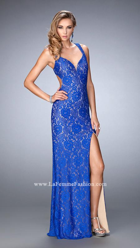 LaFemme 22398 -   Elegant lace gown with a side slit and open back. The gown is embellished with rhinestones and a nude lining. Back zipper closure.    Colors available - Dark Papaya, Electric Blue, Forest Green, Plum