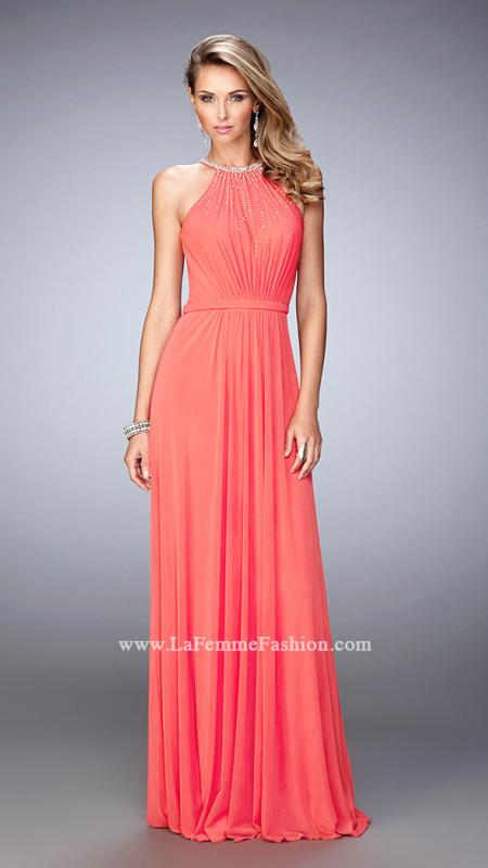 21974 -   Elegant net gown with a sweetheart neckline and a high neck gathered overlay. The neckline and bodice are embellished with tastefully placed rhinestones. Back zipper closure.    Colors Available - Black, Pink Grapefruit, Powder Blue, White