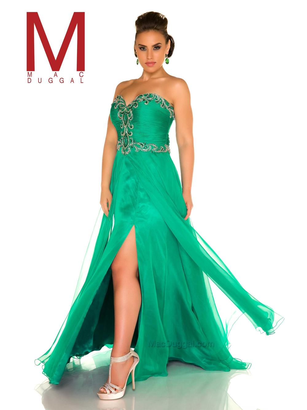 65467 -  Shine bright in this floor length, emerald plus size prom dress that looks stunning both on and off the dance floor. As one of the top plus-size dresses in the collection, the strapless sweetheart neckline is perfectly adorned around fabulous ruching with glass cut stones and sequins.Lastly, the flowing chiffon skirt is complete with a demure breakaway and high leg slit.  Colors Available- Emerald
