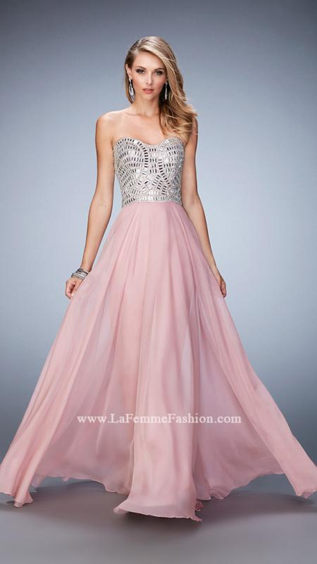 22137 -   Stunning chiffon gown with soft sweetheart neckline. The bodice is sparkling with intricately placed crystals and gems. Back zipper closure.    Colors available - Black, Dark Blush, Marine Blue