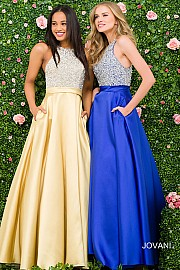 VN49432 -  mbellished high heck ball gown with pockets.     Colors Available - Pink, Yellow, White, Royal