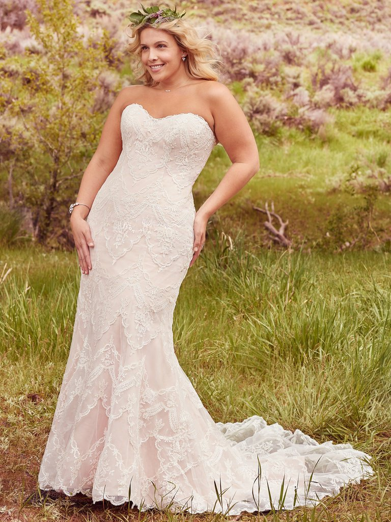 Kirstie -  Elegant lace appliqués drift atop tulle to create this breathtaking bohemian sheath wedding dress, with a timeless, romantic sweetheart neckline. Finished with covered buttons over zipper and inner corset closure.     Colors Available - All White, All Ivory, Ivory over Antique Blush