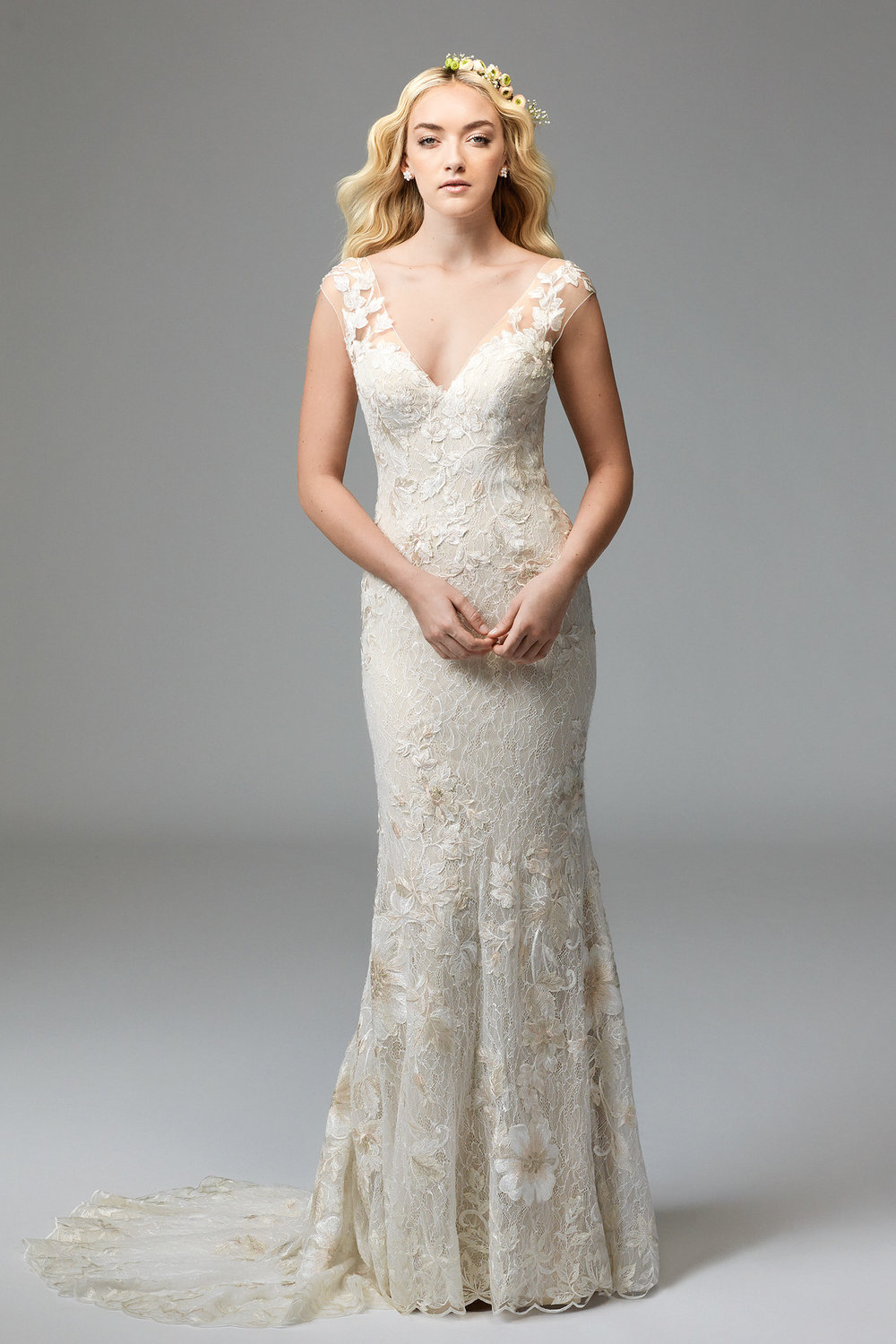 Doyle -  This dress was designed for the whimsical romantic. Doyle's Tillie Chantilly Lace plays backdrop to its dramatic Wildfell Floral Motifs. The front of this fit-and-flare gown features a flattering V-neckline, which is mirrored by a dramatic plunge in the back. Sweep Train.  Colors Available - Ivory, Dusty Pink