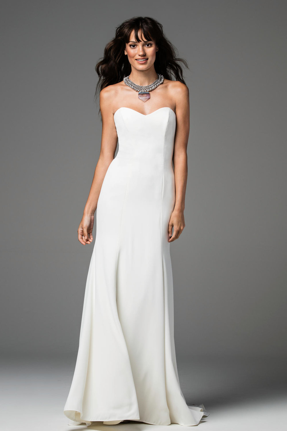 Caspia -  Caspia is a dream come true for the modern minimalist. Clean and classic Georgette Poly over Stretch Satin Lining is a perfect complement to this simple, chic silhouette. For the bride who loves to accessorize, Caspia's simplicity is the perfect place to start. Sweep train.  Colors Available - Ivory Only