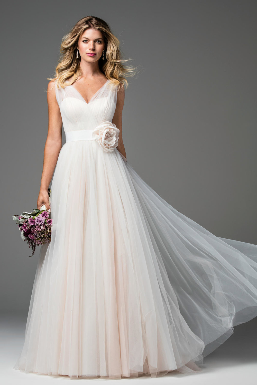 Agnessa -  Feminine and classic, Agnessa is the ultimate wedding dress. With cascading tulle cinched at the waist with our slimming Blythe Sash, this gown is perfect for the bride who loves romance. Chapel train.     Colors Available - Ivory, Amaranth