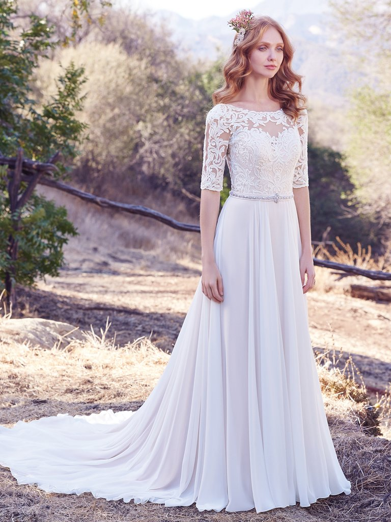 Darcy -  This Aurora Chiffon A-line wedding dress features a lace bodice with illusion elbow sleeves and illusion bateau neckline accented in lace appliqués. A Swarovski crystal belt motif and plunging V-back add touches of alluring romance. Finished with covered buttons over zipper closure.  Colors Available - White, Ivory, Ivory/Blush