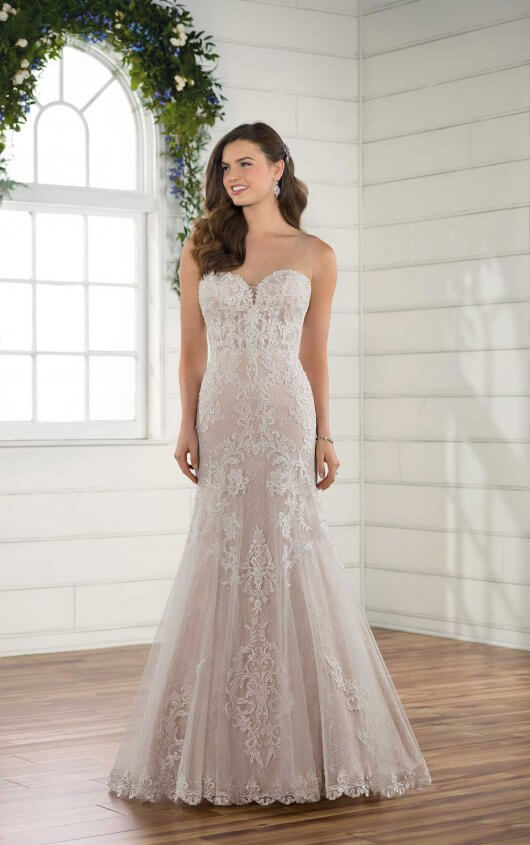 D2451 -  Layers of breathtaking lace come together to give this lace wedding dress from Essense of Australia a unique and romantic update. A sweetheart neckline frames the face beautifully and sets the stage for romance, highlighting a sheer, lace-detailed bodice. Featuring embroidered lace on top of French lace, the layers on this gown create a unique texture and depth. The rich lace pattern of the bodice continues down through the skirt and is finished with a scalloped-lace hem. The sheer bodice continues around the back and is accented with a slight train. The back of this lace wedding dress zips up beneath fabric-covered buttons and is available beaded or unbeaded.     Colors Available - White, Ivory, Ivory/Moscato
