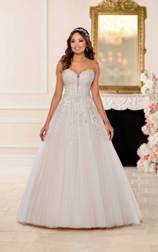 6692 -  Have a total princess moment in this dress from Stella York! This designer ballgown is covered in embellished beading that gives this dress a unique sparkle. Lace and tulle create a classic silhouette that feels anything but ordinary. A plunging sweetheart neckline adds just a hint of sexiness with kissing scalloped lace keyholes that you won't see on any other dress.    Available in - All White, All Ivory, Ivory over Moscato