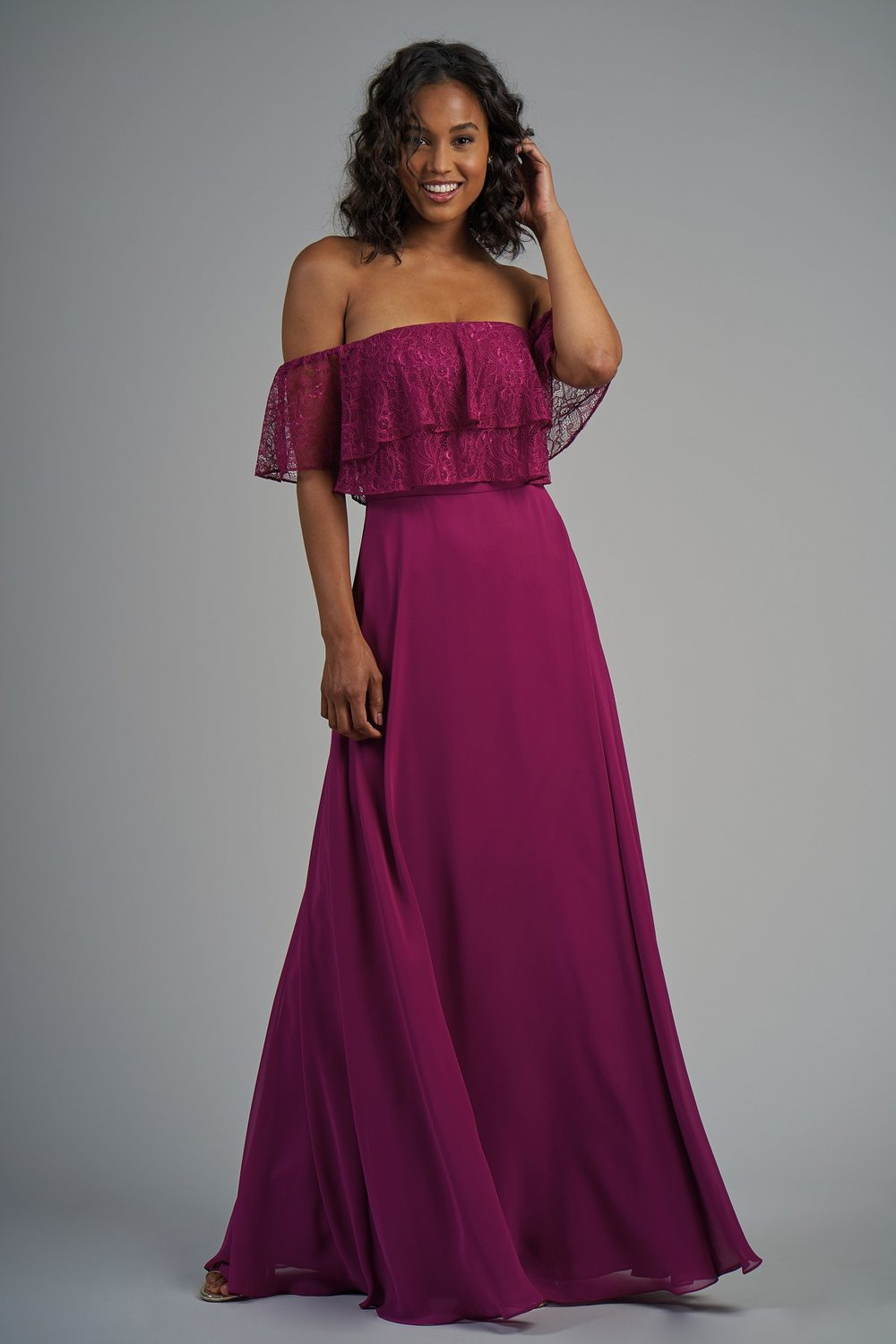 B213013 -  Beautiful lace and poly chiffon floor length bridesmaid dress with a strapless neckline and short lace fabric that fits around the arms. Layered flowy bodice and flowy skirt to complete the look.    Available in 22 colors