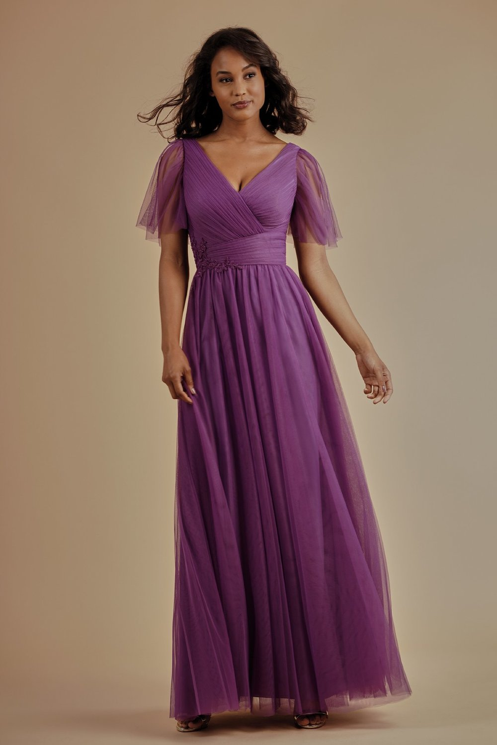 L214009 -  Pretty soft tulle floor length bridesmaid dress with a flattering V-neckline and V back. Beautiful lace detail on the bodice, gathered soft tulle short sleeves, and detailed gathers throughout the dress.    Available in 17 colors