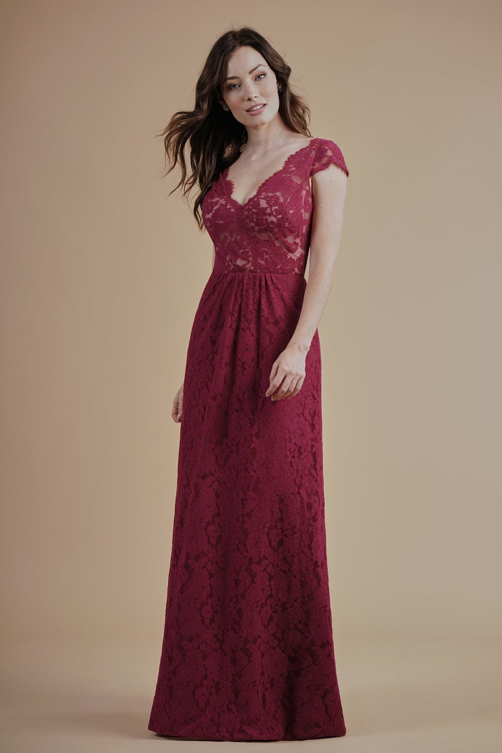 L214012 -  Pretty lace floor length bridesmaid dress with a scalloped lace V-neckline and scalloped V back. Cap sleeves and detailed gathers on the top of the skirt to complete the look.      Available in 16 colors