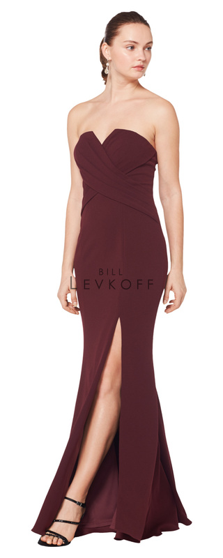 1619 -  Stretch Crepe strapless gown with a cut out front. Criss-cross pleating adorns the bodice. Off-center front slit.    Available in 10 colors