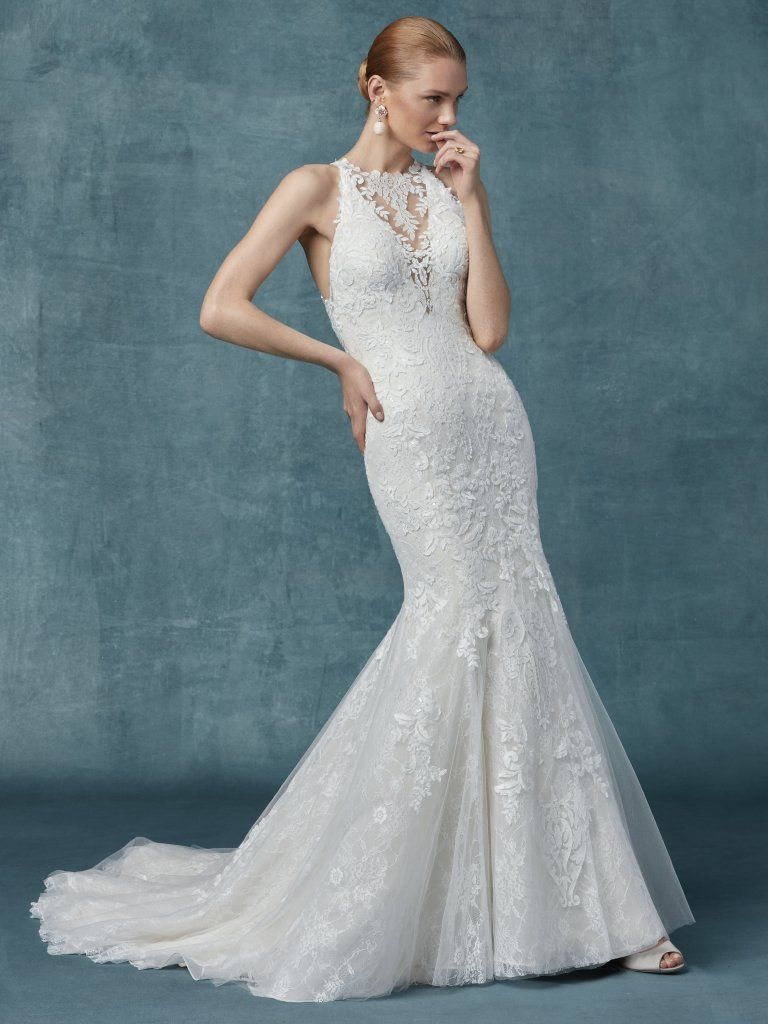 Liberty -  This lace gown features lace motifs atop allover lace in a fit-and-flare silhouette. Complete with illusion halter over plunging V-neckline and illusion halter back. Finished with covered buttons over zipper closure.    Available in: Ivory Or Ivory/Soft Blush