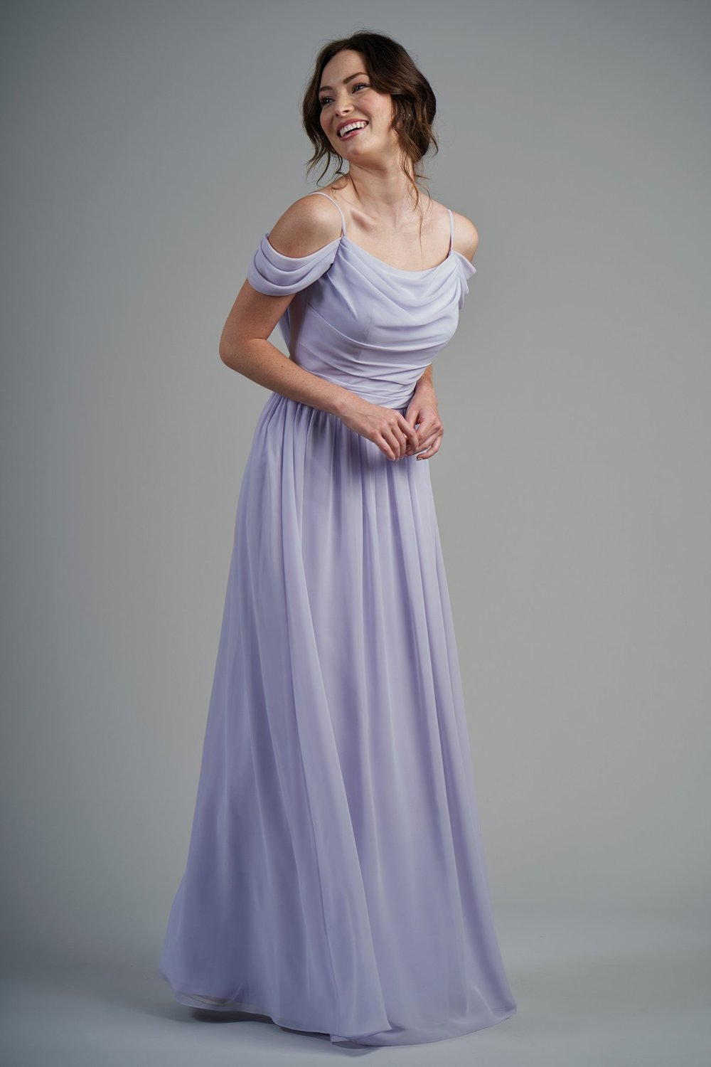 B213003 -  Beautiful poly chiffon floor length bridesmaid dress with a beautiful scoop neckline and spaghetti straps. Detailed gathers on the skirt, bodice, and fabric around the arm for a whimsical bridesmaid look.    Available in 60 colors