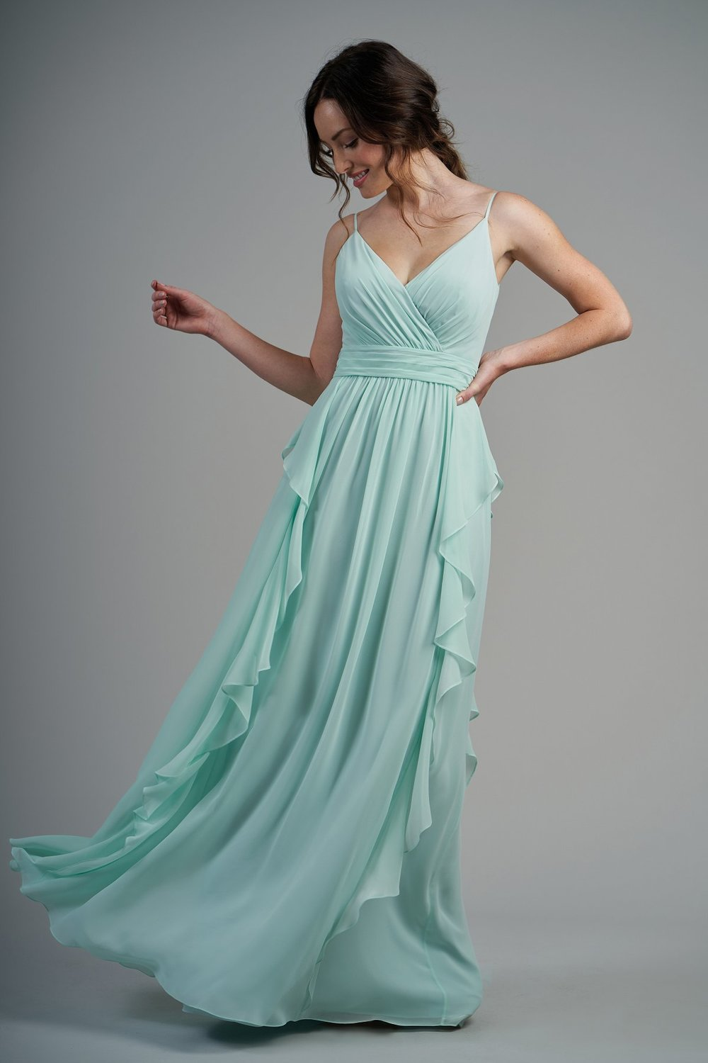 B213004 -  Pretty poly chiffon floor length bridesmaid dress with a flattering V-neckline and spaghetti straps. Beautiful detailed gathers throughout the dress and lovely ruffles on the flowy skirt.    Available in 60 colors