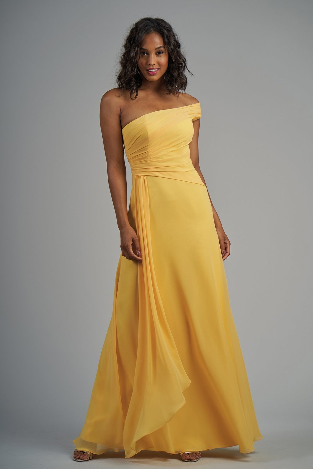 B213006 -  Pretty poly chiffon floor length bridesmaid dress with a beautiful one-shoulder neckline. Detailed gathers on the bodice and gathered flowy fabric on one side of the skirt.    Available in 60 colors