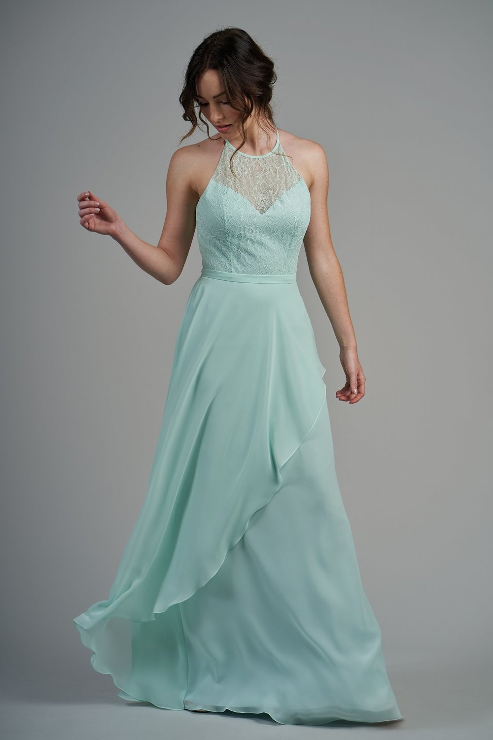 B213012 -  Pretty lace and poly chiffon floor length bridesmaid dress with a jewel neckline, open back bodice, and layered flowy skirt to complete the look.    Available in 22 colors