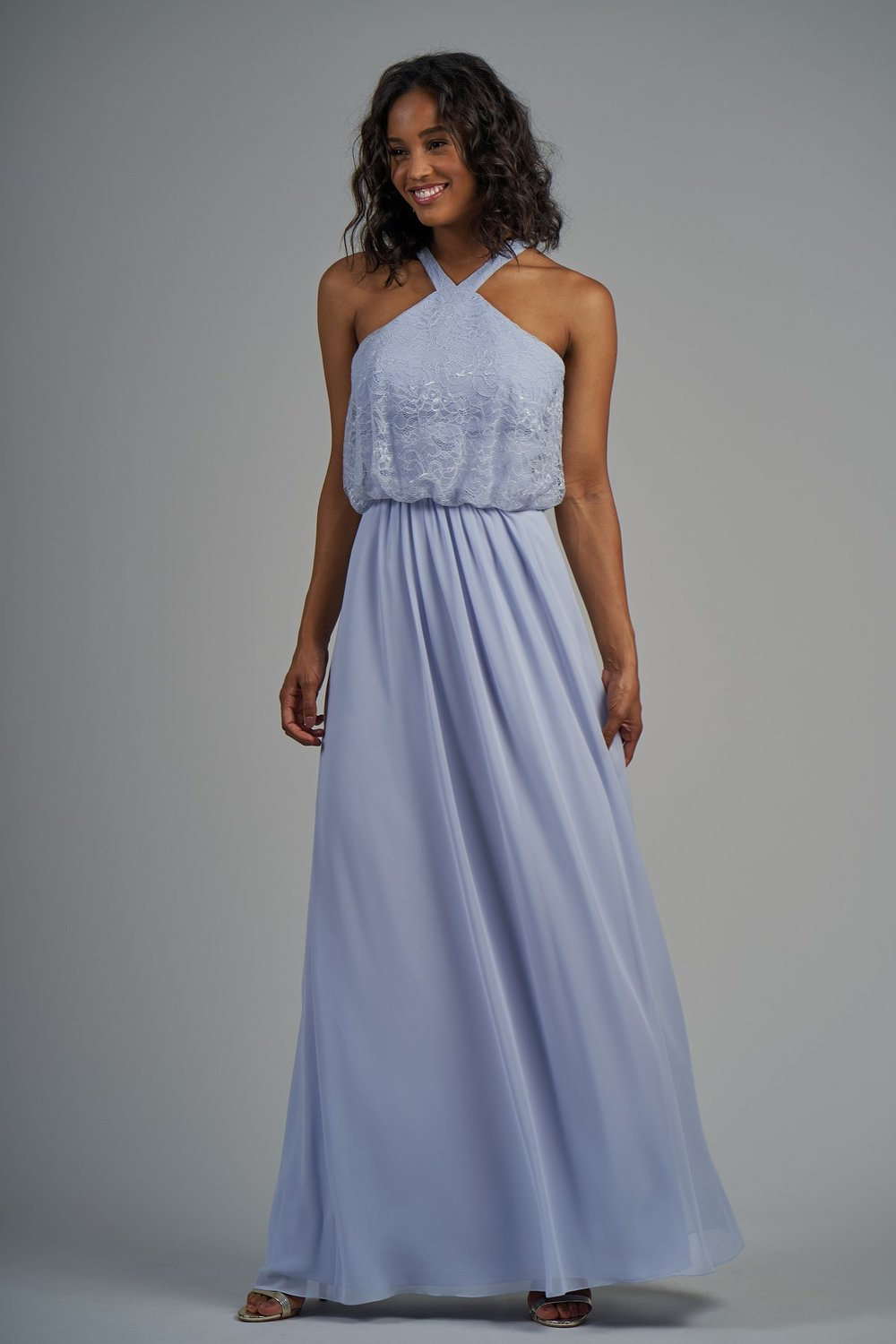 B213014 -  Pretty lace and poly chiffon floor length bridesmaid dress with a high neckline and flowy lace bodice. Detailed gathers on the flowy skirt to complete the look.    Available in 22 colors
