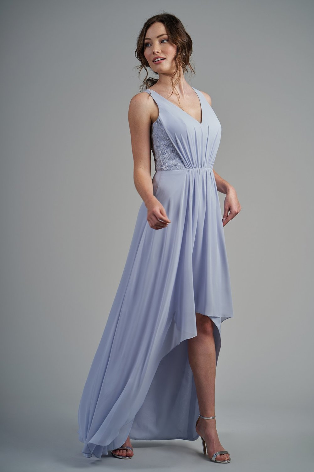 B213015 -  Beautiful poly chiffon and lace high-low bridesmaid dress with a flattering V-neckline and keyhole back. Detailed gathers throughout the dress and lace detail on the sides of the bodice to complete the look.    Available in 22 colors