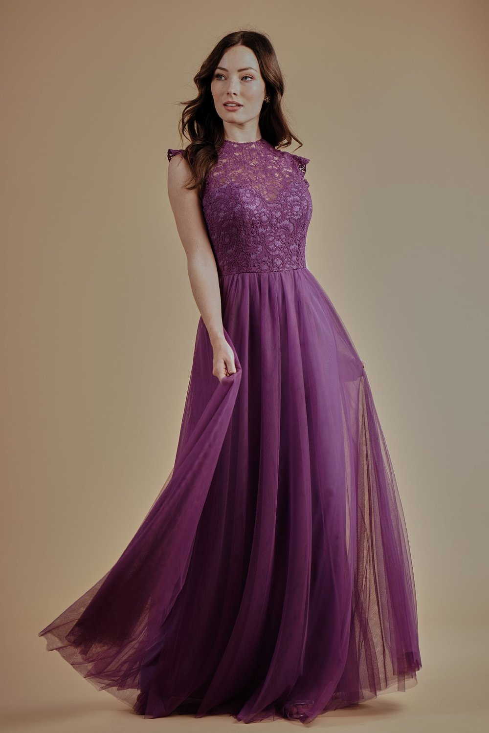 L214007 -  Pretty lace and soft tulle floor length bridesmaid dress with a high neckline, beautiful ruffles on the armholes, and detailed gathers on the flowy skirt.    Available in 17 colors