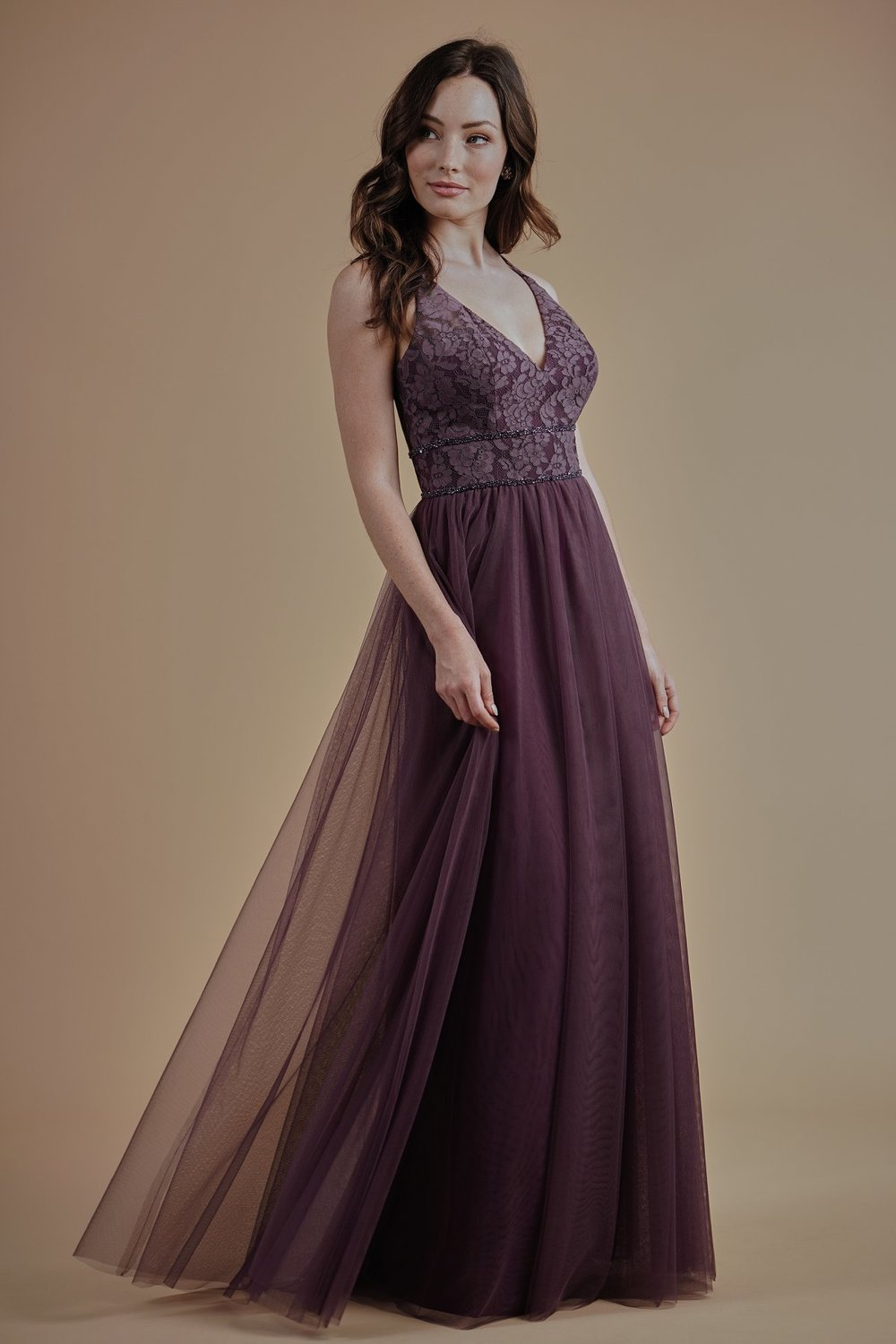 L214008 -  Beautiful lace and soft tulle floor length bridesmaid dress with a flattering V-neckline. Detailed beading on the bodice and a flowy skirt.    Available in 17 colors