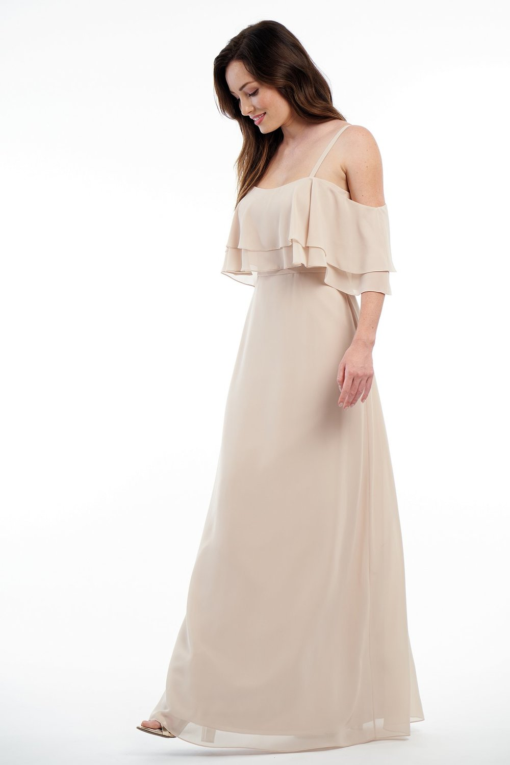 P216001 -  Beautiful charlotte chiffon floor length bridesmaid dress with a straight neckline and spaghetti straps. A layered flowy bodice with fabric that goes around the arms and flow skirt to complete the look    Available in 41 colors