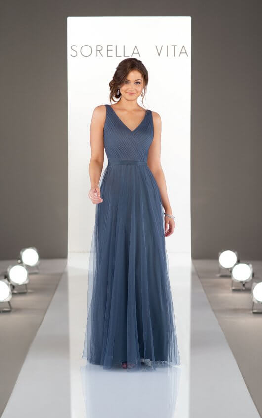 9156  - Keep it simple! This timeless bridesmaid dress is a universal classic, and the perfect accompaniment to any wedding theme. With an elegant V-neckline that elongates the frame, the Soft English Net skirt gently floats away from the body for an effortless walk down the aisle, flattering every figure in your bridal party.    Available in 9 colors
