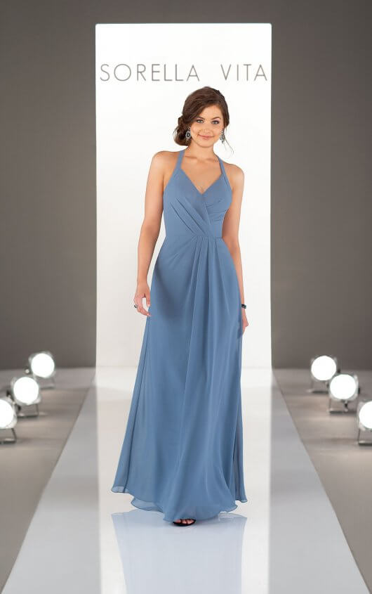 9224 -  Sophisticated and elegant, with a touch of sass … this bridesmaid dress has it all! With just the right amount of modern style and traditional vibes, the halter straps create a deep V-neckline that's fresh and figure-flattering. Available in over 30 colors, this chiffon gown with its soft, gathered pleating at the natural waistline will keep bridesmaids looking effortless, romantic and totally cool.    Available in 33 colors