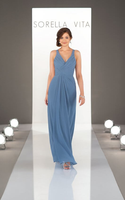 9214 -  Classic and sweet, this bridesmaid dress has the right amount of detail in all the right places. With thoughtful ruching along the bodice and soft pleats that gather at the waist, this curve-flattering dress is feminine and oh-so-lovely. Available in over 30 colors, this chiffon dress creates a subtle yet stunning accompaniment to any beautiful bride!      Available in 33 colors