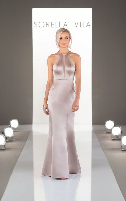 9256 -  Chic and oh-so-sleek! This modern bridesmaid dress will take your party to the future of bridesmaid fashion. With a fitted silhouette and subtle chiffon micro-plunge from the high halter neckline to the waist, this runway-ready satin gown is the perfect combination of modern sexiness and elevated elegance.    Available in 33 colors